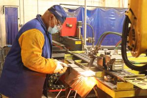 A welder training hands-on in welder classes