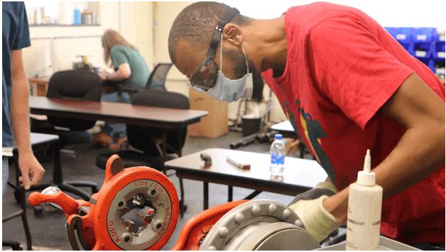 A student training in plumbing technician school