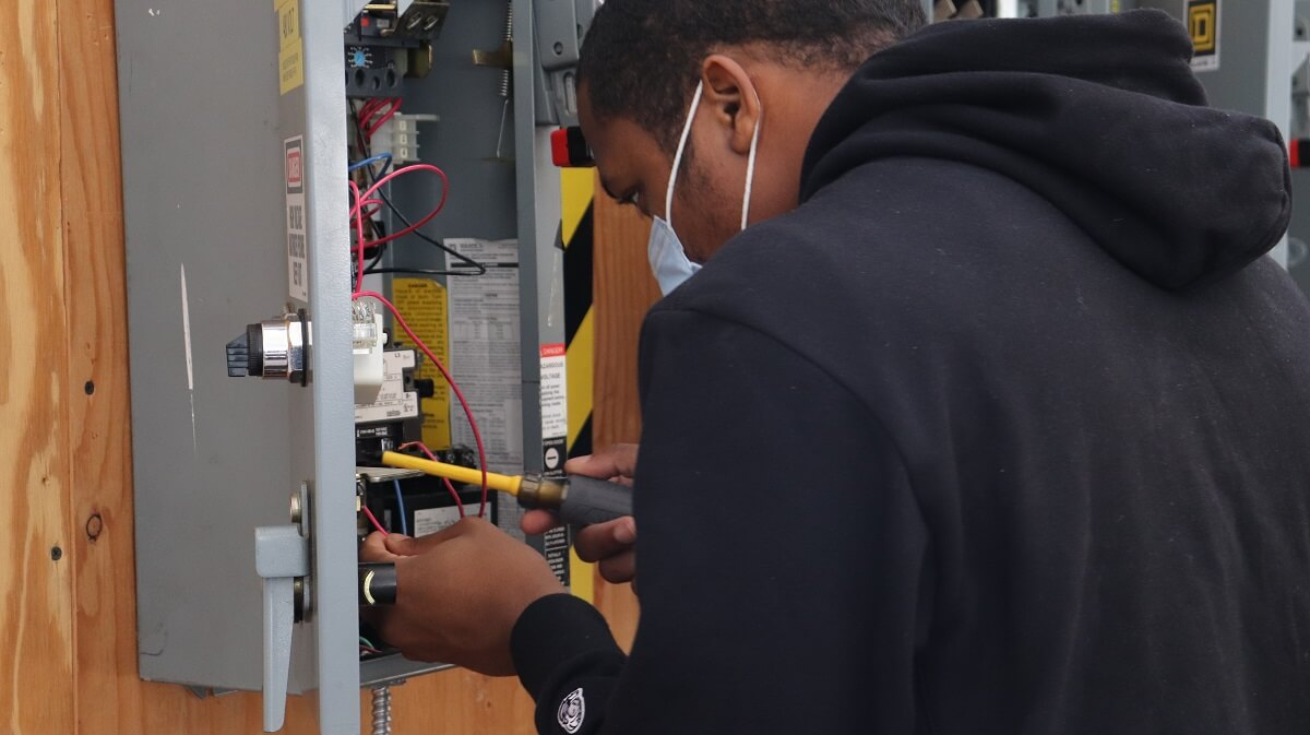 Hands-on electrician training in an electrician program