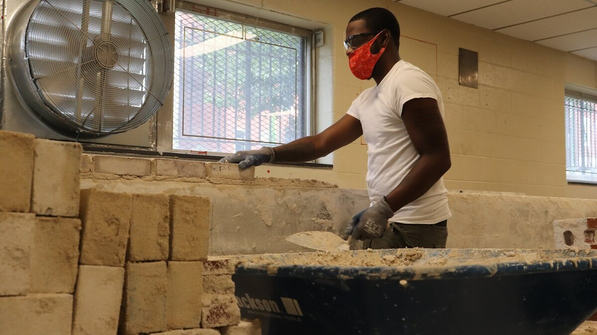 Student in indoor construction training for construction jobs
