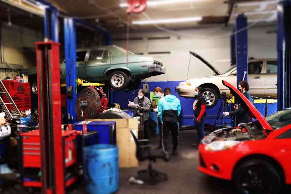 Students at automotive trade school get hands-on training as auto repair technicians