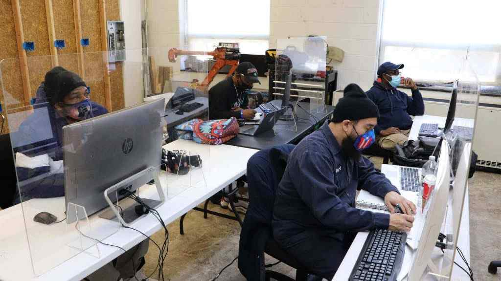 Students in electrician school learn how to be an electrician through classroom and hands-on training